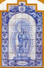 Seville - tiled Madonna of Rosary on church Capilla dos de Mayo
