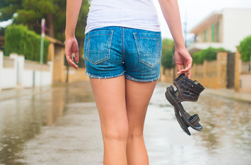 Woman enjoying walking in the rain.