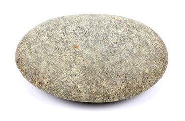 The round stone is isolated on a white background