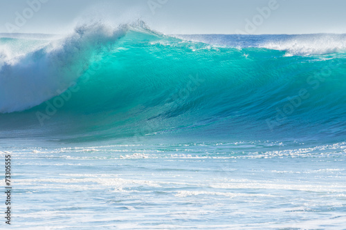 Waves breaking on the shore of Madeira - 73305555