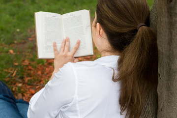 woman in park reading a book
