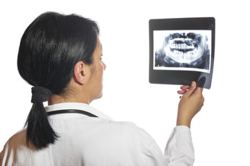 Dentist checking x-ray at dental clinic
