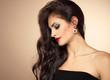 Fashion salon model with beautiful hairdo posing in studio