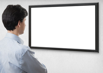 businessman staring at tv with blank screen
