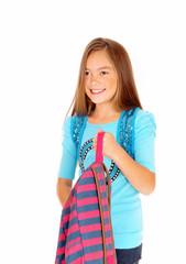 Girl holding her backpack.