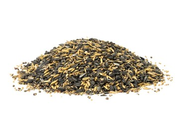 Pile of mixed bird seeds on white background