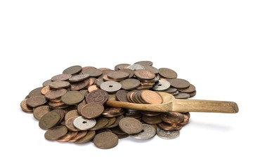 pile of danish coins on white background with a wooden spoon