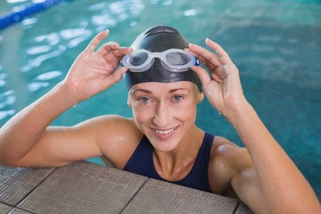Close up portrait of female swimmer in pool at leisure center