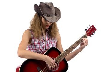 Photo of young cowgirl with the guitar