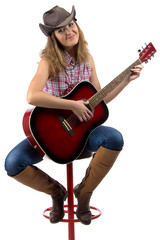Photo of sitting cowgirl with the guitar