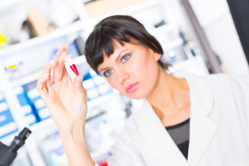 woman in a laboratory with microtube test tube  in hand and PCR