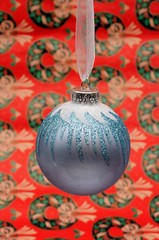 Blue frosted Christmas bauble © Arena Photo UK