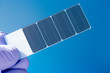silicon crystal with photovoltaic cells in the hand of the scien - 73308753