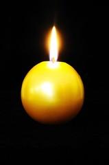 Gold Christmas candle © Arena Photo UK