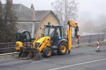 Industrial machines working in road construction