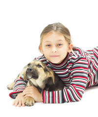 little girl hugging her four-footed friend on a white background