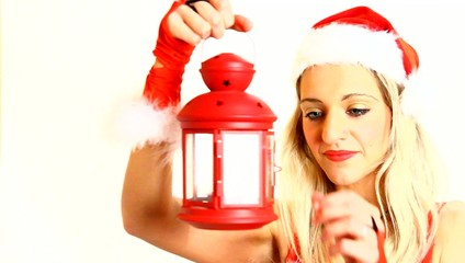 santa claus woman with a lantern