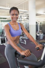 Fit woman working out on the exercise bike