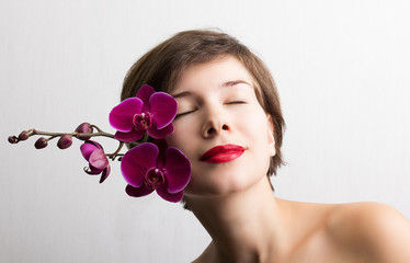 Beautiful girl with orchid flowers