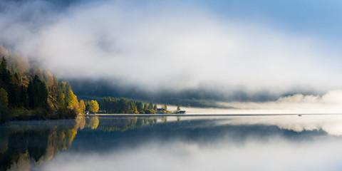 idyllic fall mood at tyrol lake with morning dust
