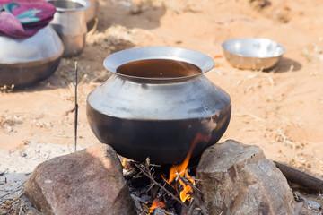 Metal pot with food on fire, Pushkar, India
