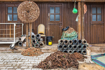 Fishing equipment and octopus pots in front of a fisherman hut i