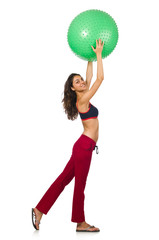 Woman exercising with ball isolated on white
