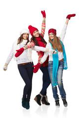Full length three happy winter girls