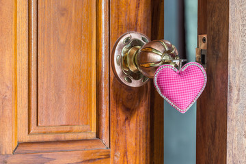 close up key of love on door handle, doorknoob