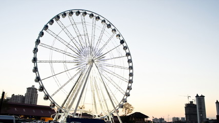 Ferris wheel in twilight, Day to Night. Time lapse.