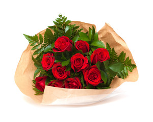 bunch of red roses in florist wrapping