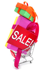 gifts and a signboard with the word sale in a shopping cart