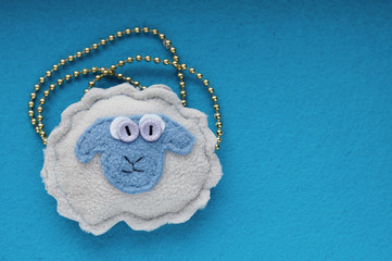 Sheep handmade on a blue background