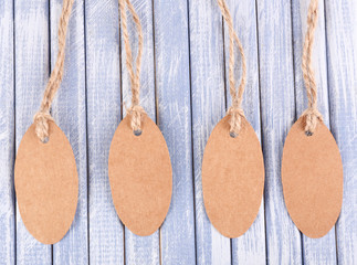 Brown tags on wooden background