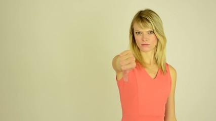 woman showing thumbs on disagreement - studio