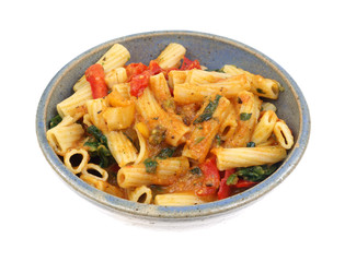 Rigatoni with vegetables with a cheese sauce in bowl