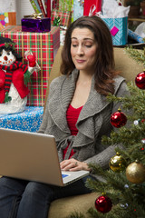 Woman shopping online for Christmas presents.