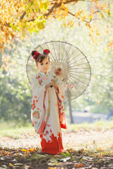 Girl in traditional Japanese kimono with umbrella
