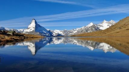Matterhorn and Weisshorn mirroring in lake Stellisee