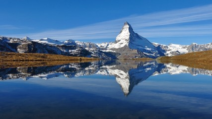Snow capped Matterhorn mirroring in lake Stellisee