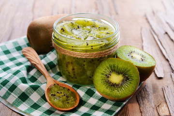 Delicious kiwi jam on table close-up