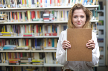 young student showing blank cover