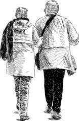 elderly spouses on a walk