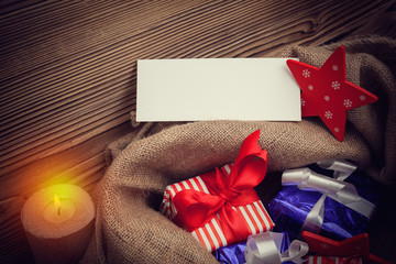 xmas sack with gifts and blank greeting card