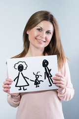 woman holding picture with happy family