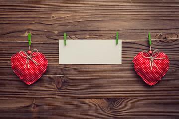 empty greeting card between xmas hearts