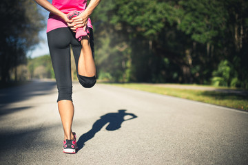 Woman is stretching before jogging.Fitness and lifestyle concept
