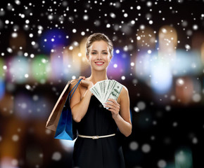 smiling woman in dress with shopping bags