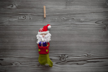 santa stocking with giftbox attached to clothespin