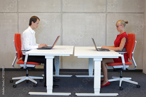 canvas print picture business couple  in correct sitting posture at workstations